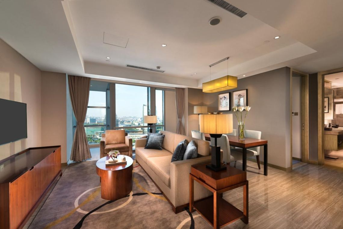 Oakwood Hotel & Residence Suzhou's three-bedroom apartment's living room