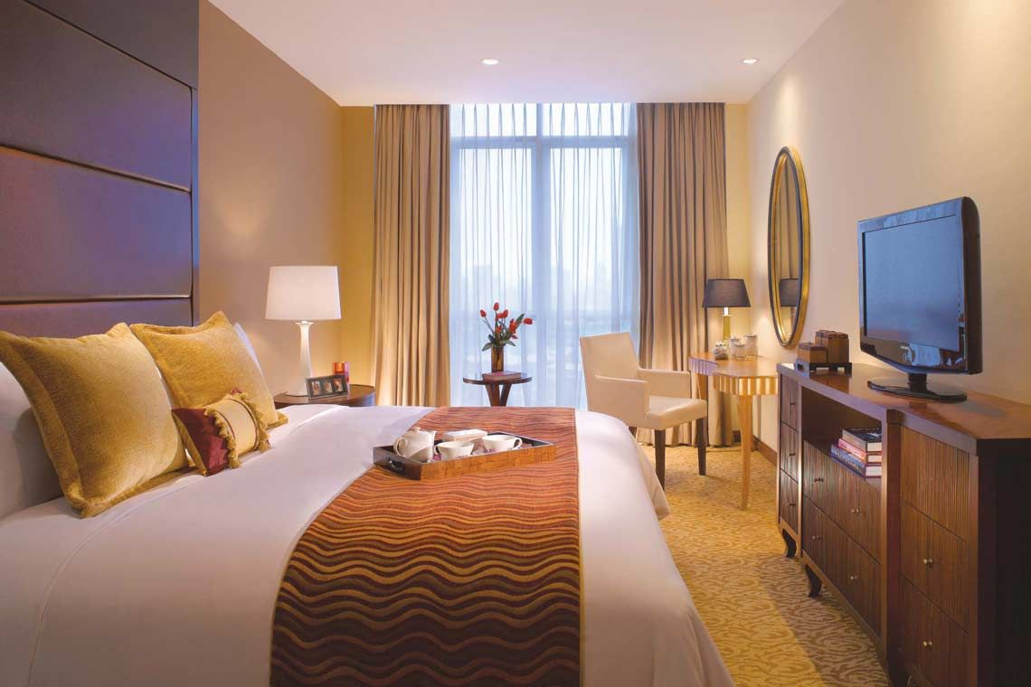 Oakwood Premier Cozmo Jakarta's two-bedroom deluxe apartment's master bedroom