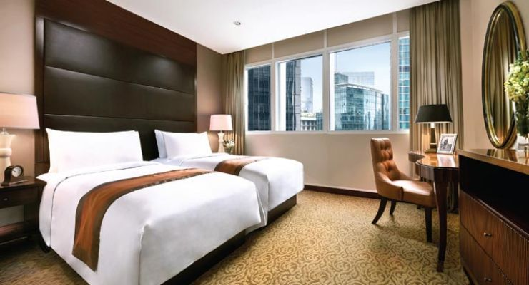 Oakwood Premier Cozmo Jakarta one-bedroom executive twin's master bedroom