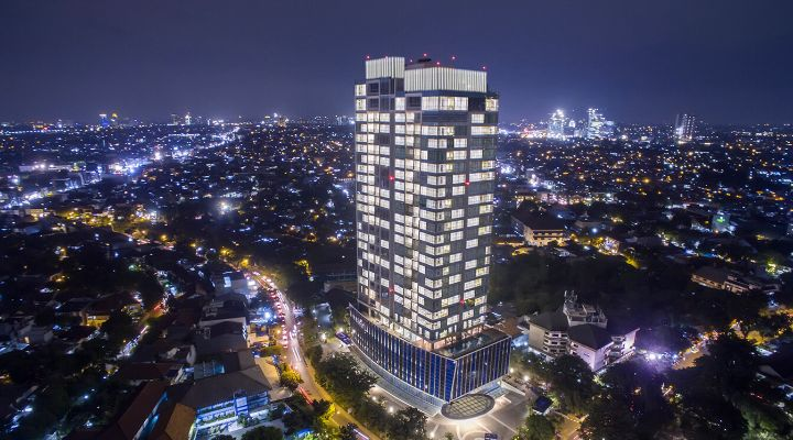 Oakwood Suites La Maison Jakarta exterior at night