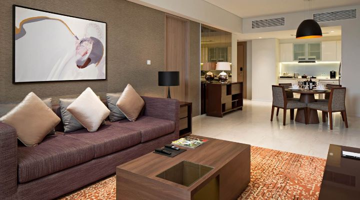 Oakwood Hotel & Residence Surabaya's one-bedroom apartment's living room
