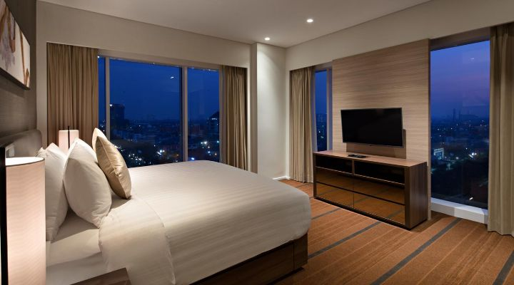 Oakwood Hotel & Residence Surabaya's two-bedroom apartment's master bedroom