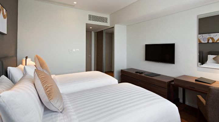 Oakwood Hotel & Residence Surabaya's two-bedroom apartment's second bedroom