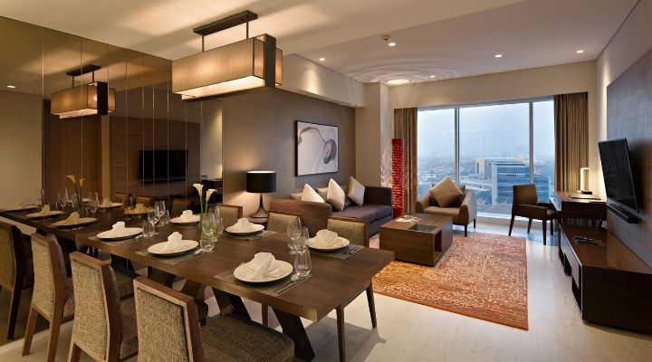Oakwood Hotel & Residence Surabaya's two-bedroom apartment's living room