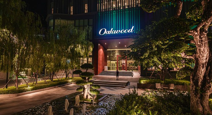Oakwood Hotel & Residence Sri Racha's facade at night