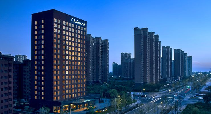 Oakwood Apartments Yangzhou's facade night