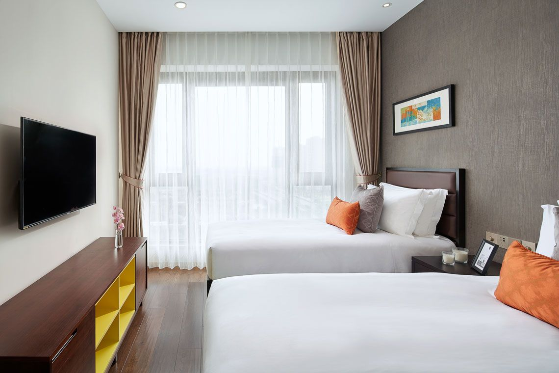 Oakwood Apartments Yangzhou's three-bedroom apartment twin bed