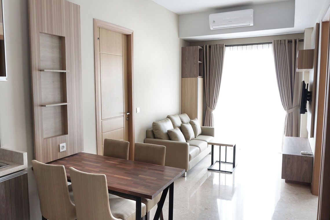 Oakwood Residence Cikarang's three-bedroom apartment's living room
