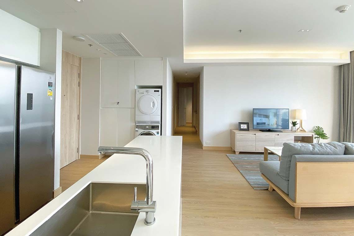 Oakwood Suites Bangkok's two-bedroom executive's living room and kitchenette