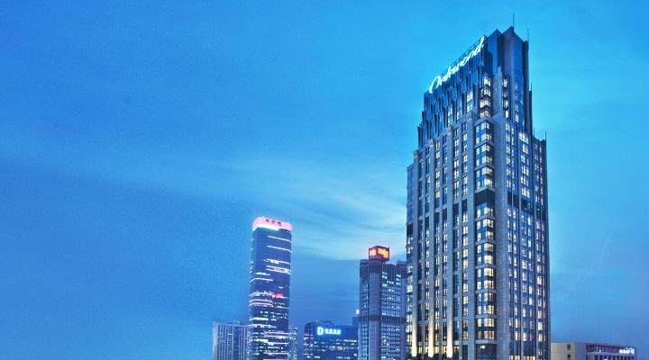 Oakwood Premier Guangzhou exterior in the evening